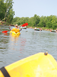 Sit-on-top kayaks, canoes and rafts float Tahlequah's Illinois River in northeastern Oklahoma daily during the summer months.  Several float outfitters and campgrounds can be found along the river banks off Highway 10.