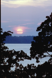 A peaceful sunset washes over Fort Gibson Lake at Sequoyah State Park & Lodge.