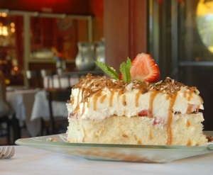 The Strawberries & Cream Cake at Cheever's Cafe in Oklahoma City is an irresistible and perfect end to a delightful meal.