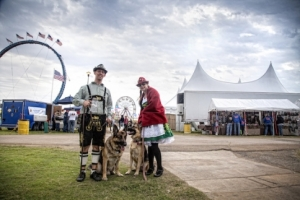Many festival-goers don Alpine hats and lederhosen to celebrate at Tulsa Oktoberfest in style.