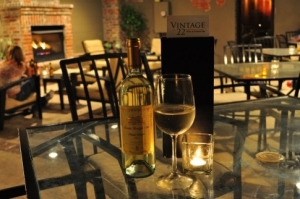 Order a glass of wine at Vintage 22 in Ada and enjoy a cozy atmosphere on their outdoor patio, which features a roaring fireplace and dim, romantic lighting.