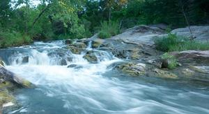 The Blue River in Tishomingo is a popular spot for fishing and is known for its beautiful cascades.