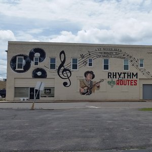 This mural in the town of Duncan where Hoyt Axton and his mother Mae Boren Axton once lived pays tribute to the country music stars. It includes lyrics from one of Hoyt's most famous songs and Mae Boren's hit she wrote for Elvis.