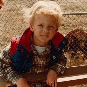 A young Ryan Tedder poses for a photo with a bear at the Tulsa Zoo.