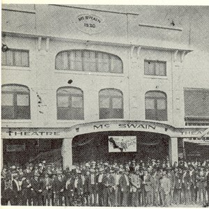 A group gathers outside the McSwain Theatre in the early 1920's to celebrate a performance