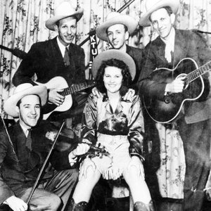 "Patti Page and the ""Oklahoma Outlaws"" pose for a photo."