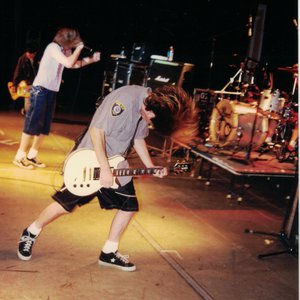 Jesse Davis of The Nixons performing on guitar