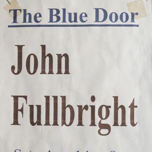 John Fullbright flyer on the wall at The Blue Door