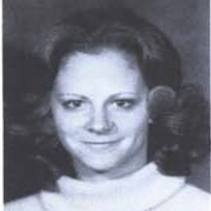 Reba McEntire smiles for her 1974 yearbook photo as a freshman at Southeastern Oklahoma State University.