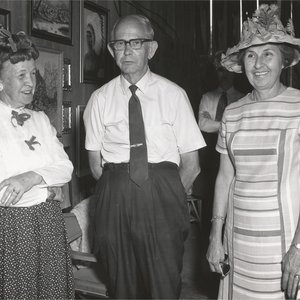 Albert poses with two ladies