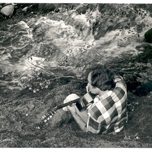 Mason Williams playing guitar beside Salt Creek in 1978
