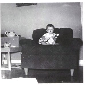 Ronnie Dunn at 6 months old with his first guitar.