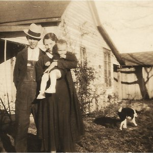 Albert Brumley and his wife Goldie with their first born son, Bill, in 1934