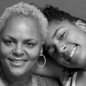 Wayman Tisdale's wife Regina and their daughter in 2008