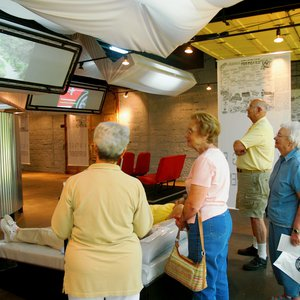 Visitors view the interactive video exhibits at the Route 66 Interpretive Center in Chandler.