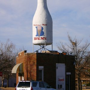 The Milk Bottle Grocery is a wedge-shaped building near the intersection of three alignments of Route 66 in Oklahoma City.