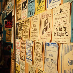 Music posters cover the walls at The Blue Door in Oklahoma City.