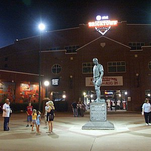 Baseball fans stroll through Johnny Bench Plaza at the Chickasaw Bricktown Ballpark in downtown Oklahoma City's Bricktown Entertainment District after a game.