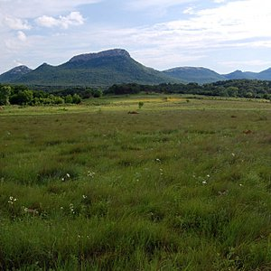 A rugged Western landscape welcomes visitors to the Wichita Mountains Wildlife Refuge.