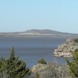 The Tom Steed Reservoir in Great Plains State Park offers water recreation amid the rugged beauty of the rocky shores.