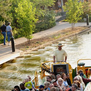 Water taxis escort tourists through the canals of the Bricktown Entertainment District in downtown Oklahoma City.