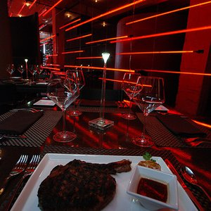 Red PrimeSteak in downtown Oklahoma City offers fine dining and signature steaks in an upscale and intriguingly red atmosphere.