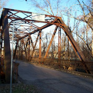 A steel-truss structure, the Pryor Creek Bridge dates to the beginning of the highway.