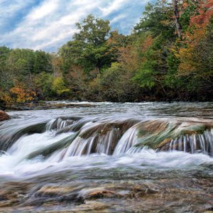 The Mountain Fork River in Beavers Bend State Park offers incredible scenery like this area where the water cascades over the rocky river bottom.  Several canoe outfitters offer rentals and float trips on the Mountain Fork River.