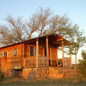 Watch as the sun rises over this adorable cabin at Hitching Post Lodging & Ranch in Kenton.