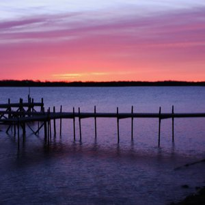 Hues of purple and pink brighten Lake Murray at sunrise on a winter day.