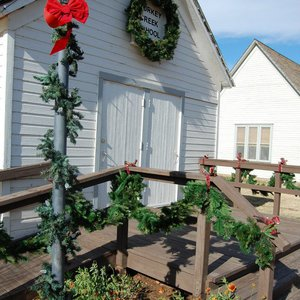 Turkey Creek School is decked out in garland for Christmas in the Village at the Cherokee Strip Regional Heritage Center.