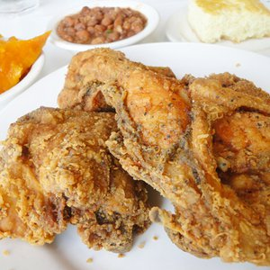 Evelyn's Soul Food in Tulsa features delicious fried chicken alongside famous sides like collard greens, sweet yams and macaroni and cheese.