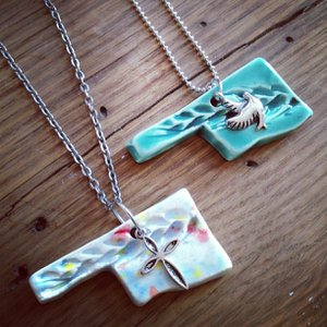 Enid's Felt Bird shop features Oklahoma-themed gifts and jewelry.
