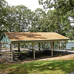 Gather with your group at the shaded picnic shelter with a lake view.