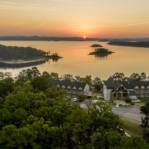 A stay at Lakeview Lodge in Beavers Bend State Park is perfect for catching Oklahoma sunsets paint the rolling hills surrounding Broken Bow Lake in golden shades of orange and purple.  Photo by Shane Bevel.