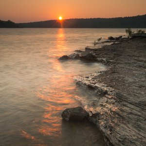 Hike along the rocky shores of Lake Wister to find the ultimate sunset-viewing spot. Photo by Kim Baker/Oklahoma Tourism.