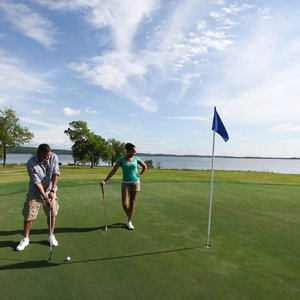 Ultradwarf Bermuda grass greens and well placed sand bunkers await you at this 5,860-yard golf course.