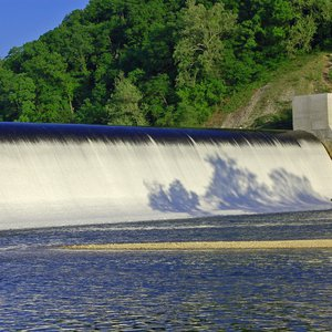 Water rushes over the spillway at Spavinaw Area at Grand Lake State Park.