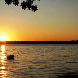 Enjoy a serene sunset on the lake at the Cherokee Area at Grand Lake.