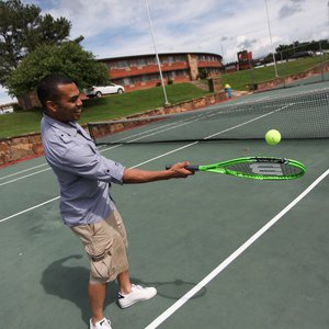 Play a hard-hitting round of tennis at Sequoyah Bay State Park. Photo by Rebekah Morrow.