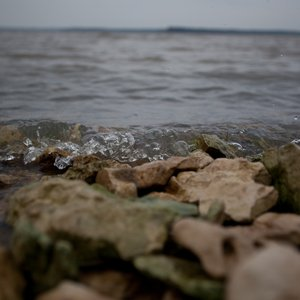 Gentle waves crash across the rocks at Hugo Lake State Park. Photo by Rebekah Workman.