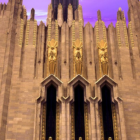 The Boston Avenue United Methodist Church, an art deco treasure, is dramatically lit by the setting sun in Tulsa.