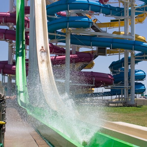 A variety of high speed water slides provide thrills to visitors at Six Flags Hurricane Harbor in Oklahoma City.  This 25-acre water park offers a variety of water rides, slides and activities for the whole family.