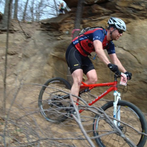 The trails at Turkey Mountain Urban Wilderness Area in Tulsa offer technically challenging elements for mountain bikers with several steep climbs and descents.