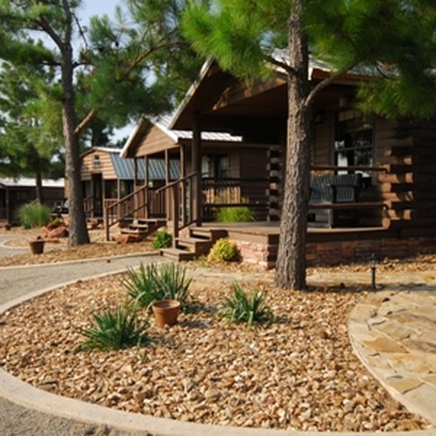 The cabins at Tatanka Ranch in Stroud offer a variety of furnishings and floor plans to meet every need.  Enjoy the rustic decor of the cabins and then take a horseback ride around the lake.