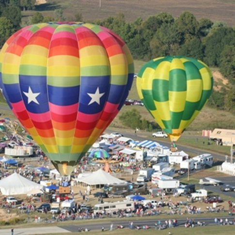Massive hot air balloons dot the landscape at the annual Poteau Balloonfest.