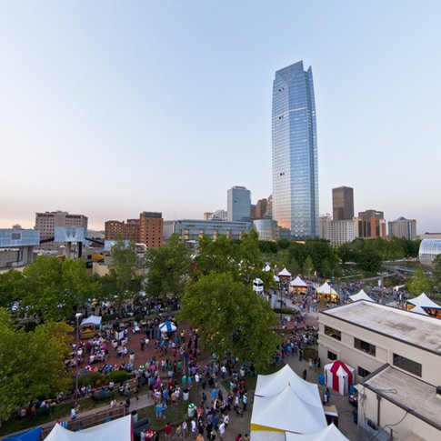 The Devon Tower and the Oklahoma City skyline tower above the festival grounds during the annual Oklahoma City Festival of the Arts, which draws nearly 1 million visitors each year.
