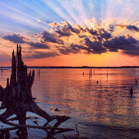 A dramatic sunset turns a Lake Eufaula cove into a dazzling waterscape.