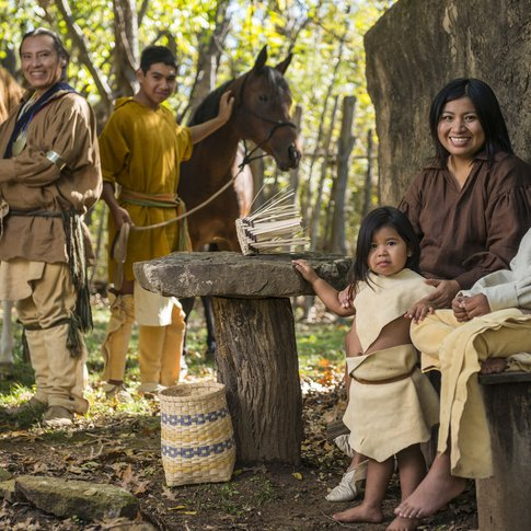 A Cherokee family demonstrates what life way like prior to relocation at Diligwa, a 1710 village at Tahlequah's Cherokee Heritage Center.