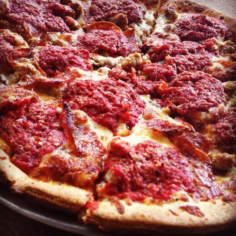 The Sicilian, which has sauce on top of the pie, is one of Hideaway Pizza's many delicious offerings.